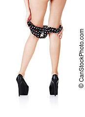 Sexy long legs in black high heels and panties down
