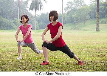asian girls streching outdoor - asian girls squat streching...