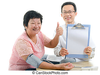 asian senior female thumbs up during medical checkup with...