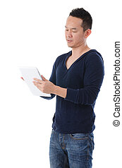south east asian manwith a tablet in casual