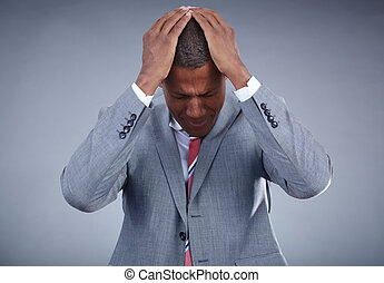 No - Photo of businessman touching his head on grey...