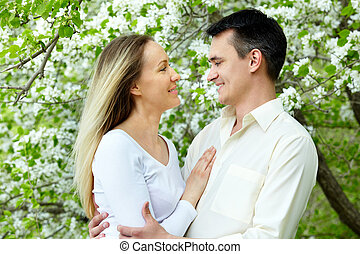 Romantic love - Portrait of young amorous couple looking at...