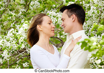 Passion - Portrait of young amorous couple looking at each...