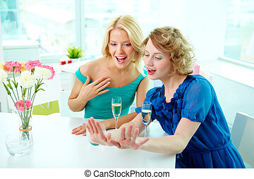Adoration - Gorgeous girls looking at manicure of one of...