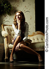 Posh girl - Image of elegant girl sitting in retro room and...