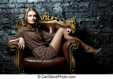 Posh lady - Image of elegant girl sitting in retro style...