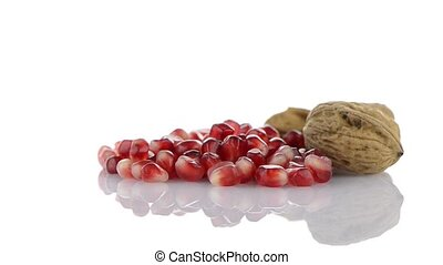 Pomegranate seed pile isolated on white background