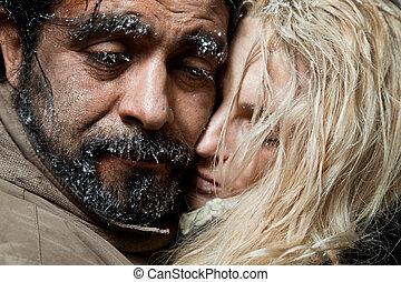 Frozen couple hugging faces