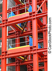 Construction frame - Red metal scaffold equipment at...