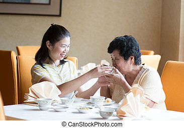 Asian Chinese family having meal - Southeast Asian Chinese...