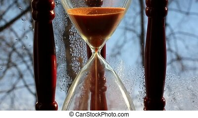 Hourglass - an ancient device for measuring time.