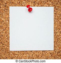 Blank memo paper on cork board