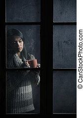 Girl with a cup of coffee or tea - Portrait of a beautiful...