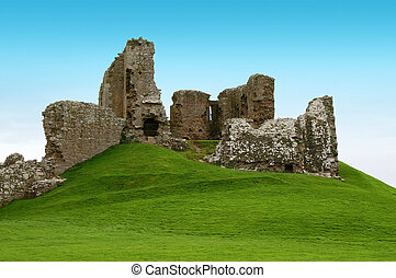 ancient ruins on a green hill covered with grass