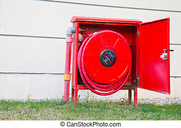 fire hose reel placed on the grass