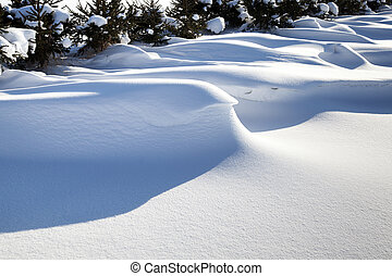 big snowdrifts - the snowdrifts formed after recently passed...