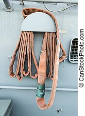 Very old and rusty fire hose from battle ship