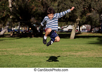 Boy jumping in park