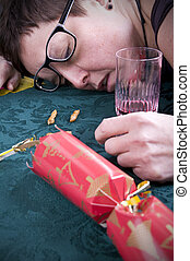 christmas party aftermath, woman asleep on table with...