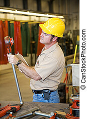 Factory Safety Inspection - Safety inspector checking the...
