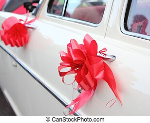 Vintage wedding car - a vintage white wedding car with red...