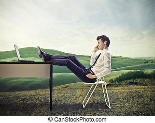 young businessman - businessman sitting at the table on the...