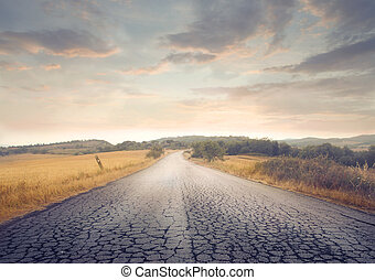 long empty road - long deserted road in the middle of fields