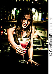Bartender - A young female bartender, photographed at work.