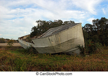 High and Dry - The wreckage of a shrimp boat deposited on...
