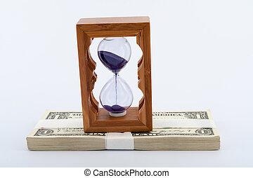 Hourglass on money