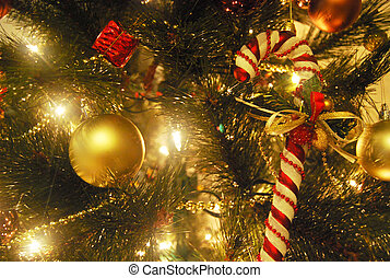 Candy cane on the christmas tree with yellow light and...