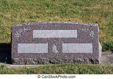 Blank headstone at a cemetery
