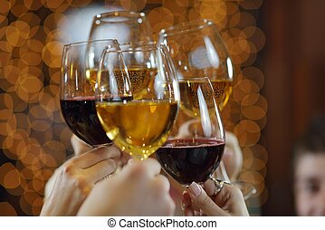 Hands holding the glasses of champagne and wine -...