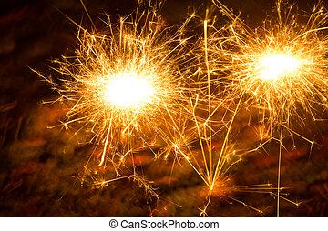 sparkler - a picture of a burning sparkler