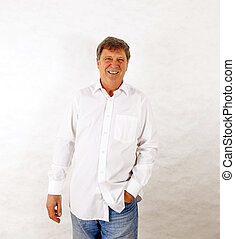 happy senior man standing gesturing against white background...