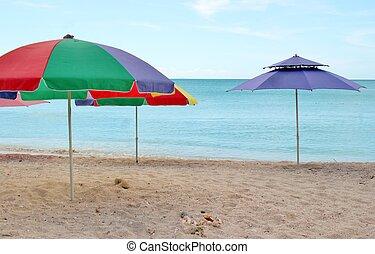 Umbrellas on the beach 2 - Colorful striped umbrellas...