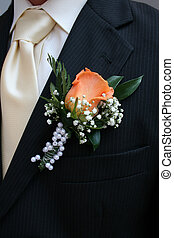 wedding detail - nice orange rose from the wedding clothes