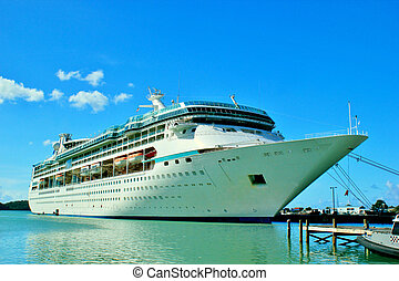 Cruise ship docked 4 - A cruise ship docked at a tropical...