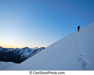 Lone climber on snow slope