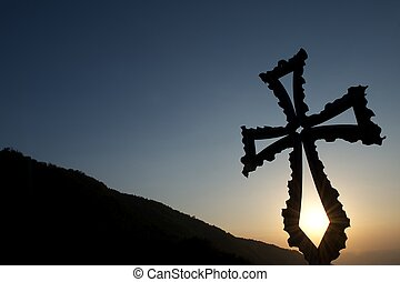 Christian cross at sunset - Metal Christian Catholic cross...