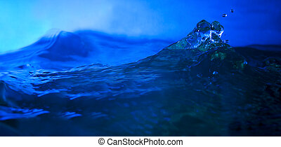 splashing water in deep blue backgr