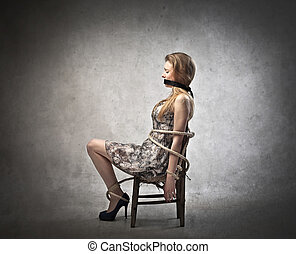 Woman tied down to chair