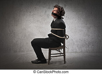Man tied down to chair - Businessman tied down to chair