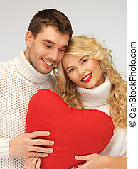 family couple in a sweaters with heart - picture of family...
