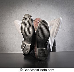 Businessman realxing on desk