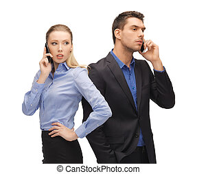 man and woman with cell phones - picture of man and woman...
