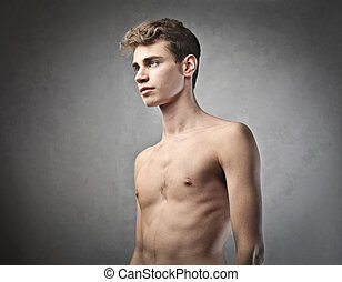 handsome boy - handsome young man on gray background