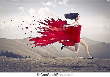 Woman in red dress with paint