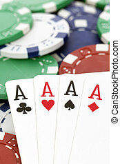 poker table - four aces with chips on a poker table