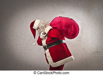 santa claus with sack - santa claus holding big sack on gray...